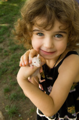 1684641-little-girl-with-mouse.jpg
